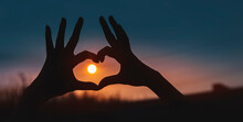 Heart Shaped Hands On Sunset