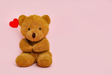 Cute Teddy Bear With Red Heart On Pink Background, Space For Text. Valentine's Day Celebration