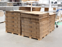Stack Of Folded Paper Box In Warehouse Or Hardware Store