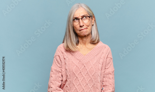 Fototapeta middle age woman looking goofy and funny with a silly cross-eyed expression, jok