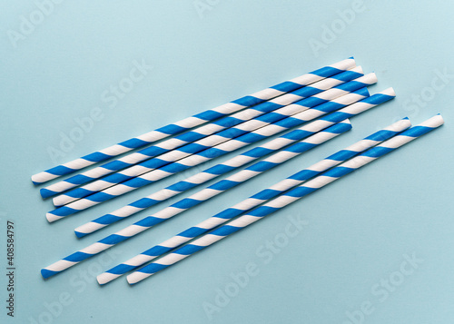 Canvas Print Drinking Striped blue paper straws on blue background