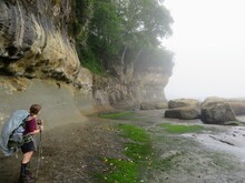 A Young Female Hiker Exploring The Shores Of The West Coast Trail, Along The Coast Of Vancouver Island, British Columbia, Canada