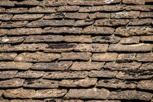 Old Slate Roof Tiles On Historic British Building With Moss And Bird Splatters - Background Or Detail