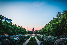 Ornamental Garden Outside Historic Building Against Sky During Sunset