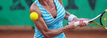 Midsection Of Female Athlete Playing Tennis In Court