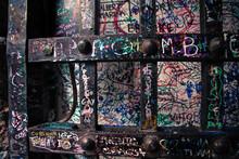 Full Frame Shot Of Metal Against Wall With Graffiti At Casa Di Giulietta