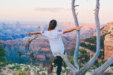 Rear View Of Woman With Arms Outstretched While Standing At Grand Canyon National Park