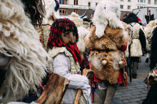 People In Street In City During Winter In Costumes