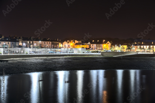 Fototapeta Beautiful night view of Greystones Harbour Marina with light reflection in the water, Greystones, Co