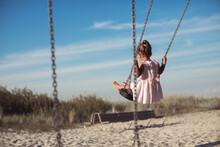 Little Girl Having Fun On A Swing