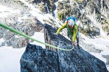 Rock Climbing Man Climbing On Mountain In Washington With Rope