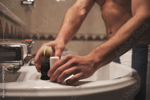 A man taking the shaving tools