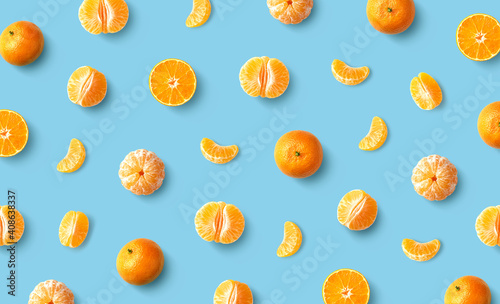 Colorful fruit pattern of fresh mandarin tangerine or clementine on blue backgro Fototapet