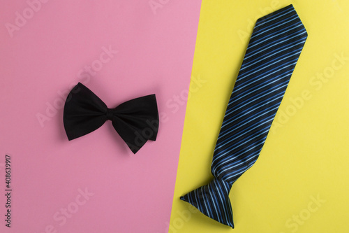 Necktie and bow tie on a colored background. Fotobehang