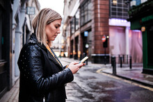 Slovak Young Woman Using Cellphone In City.