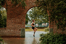 Young Woman Exercising Outdoors In Park.