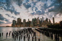 New York City Skyline During Dusk With Storm Clouds.