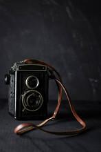 Vintage Camera On Black Background.