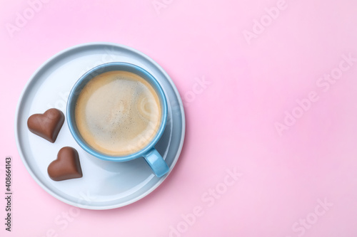Romantic breakfast on pink background, top view with space for text. Valentine's day celebration © New Africa