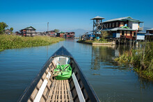 Village On Lake Inle Against Blue Sky Seen From Motorboat, Myanmar