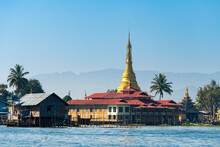 Monastery With Golden Pagoda At Lake Inle Against Clear Blue Sky, Myanmar