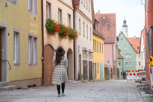 A Girl Wanders The Modern Yet Medieval Streets Of Europe.