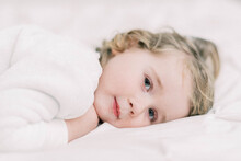 Little Toddler With Long Eyelashes Lying Down For A Nap