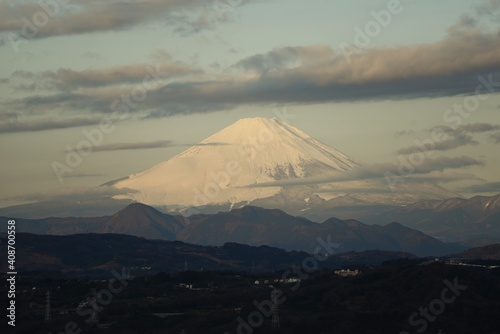 Fototapeta Mt.Fuji covered with snow that emerged from the clouds.