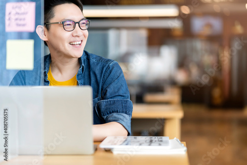 Smart attractive positive asian business male wearing glasses work remote new normal lifestyle hand use laptop tele conference onlive videocall meeting remote business ideas concept