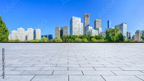 Fotografiet Empty square floor and modern city commercial buildings in Beijing,China