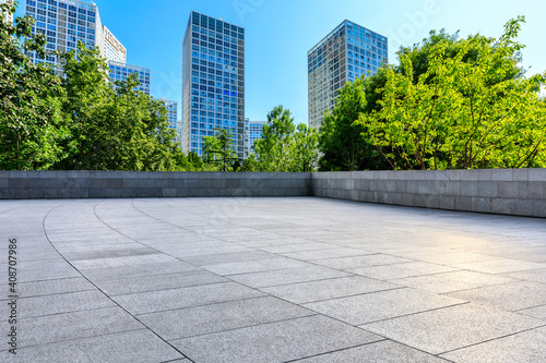 Fotografie, Obraz Empty square floor and modern city commercial buildings in Beijing,China