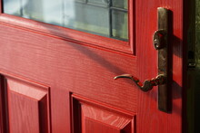 Open Wood Door With Red Paint And Brass Handle