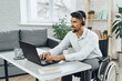 Disabled young man businessman working from home