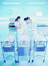 Nurses Taking Care Of Babies At The Hospital Maternity Ward