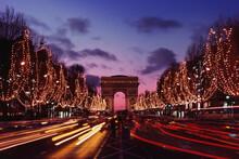 Triumphal Arch In A City At Night, Arc De Triomphe, Paris, Ile-de-France, France