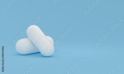 Two white pills on a blue background. Conceptual medical theme. 3D render #408729166