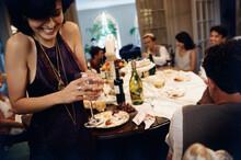 Friends Enjoying In A Dinner Party