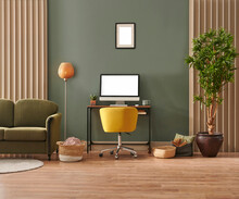 Green Room And Working Table Style With Laptop Lamp Sofa Frame And Vase Of Plant.