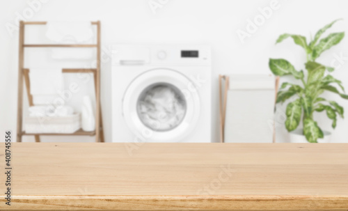 Stampa su Tela Empty wooden board over blurred laundry room washing machine background