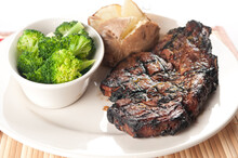 Rib Steak Grilled To Perfection With Mushrooms, Brocolli And Bak