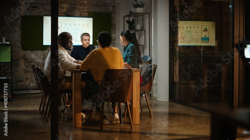 Canvas Print Diverse Multiethnic Team are Having a Conversation in a Meeting Room Behind Glass Walls in Creative Office