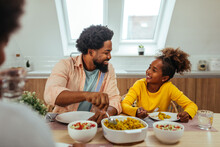 Cute Afro Family Having Lunch Together At Home