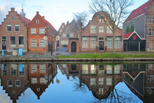 Reflections Of Historic And Colorful Houses Along Nieuwe Haven Street, Edam, North Holland, Netherlands