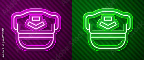 Photo Glowing neon line Pilot hat icon isolated on purple and green background
