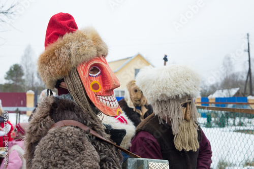 Fotografering People in demon masks are caroling in a Russian village