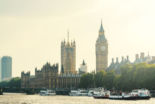 The Palace Of Westminster And The Clock Tower With Boats On The River Thames In London, England, UK