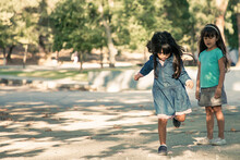 Pretty Black Haired Little Girls Playing Hopscotch In City Park. Full Length, Copy Space. Childhood Concept