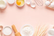 Ingredients for baking on light pink background.