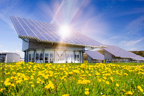 Fotomural renewable energy with sun panels on roof of an building