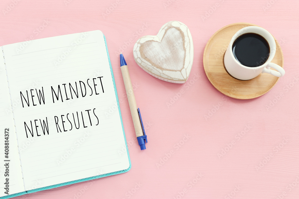 Fototapeta top view image of table with open notebook and the text new mindset new results. success and personal development concept
